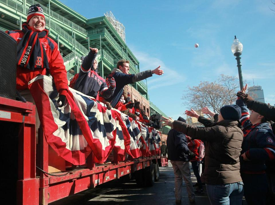 Truck Day festivities at Fenway Park included tossing souvenir baseballs to fans.